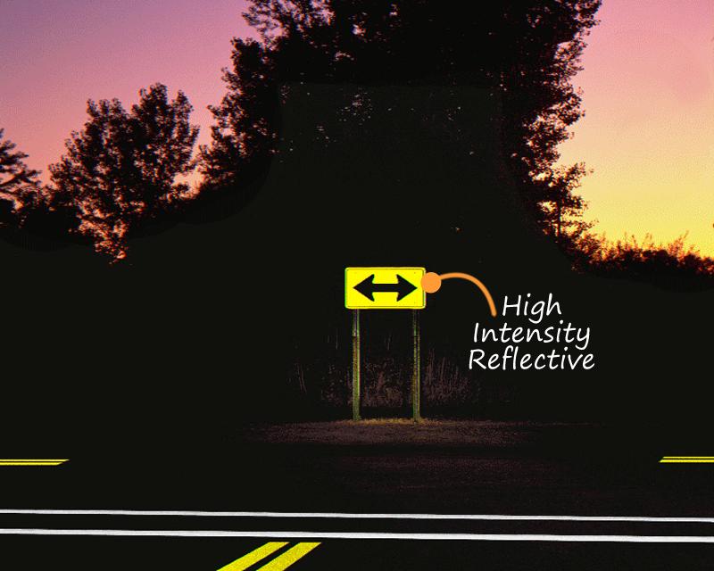 Arrow traffic sign at night