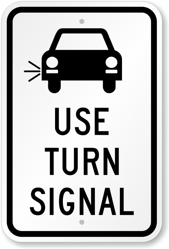 Car Using Turn Signal On Road