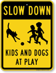 Kids And Dogs At Play Slow Down Sign