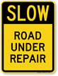 Road Under Repair Slow Down Sign