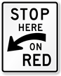 Stop Here (Arrow) On Red Traffic Sign