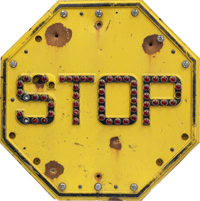 Yellow stop sign with red cataphotes