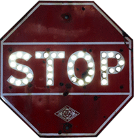 Red Stop sign with glowing cat's eyes