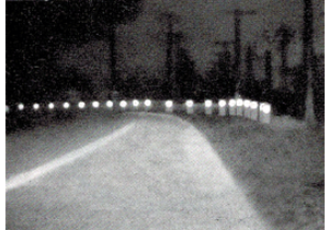 Wooden guardrails with cat's eyes in 1948