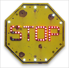 Reflective yellow stop sign
