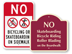 No Bikes on Sidewalk Signs