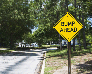 Bump ahead sign