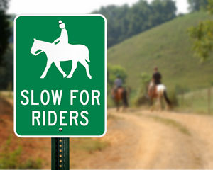 Slow for riders sign