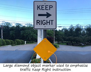 Large yellow reflector, diamond shaped sign