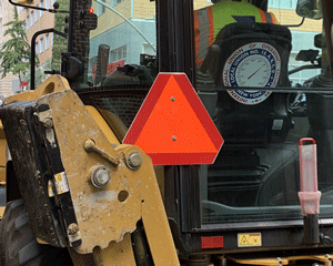 SMV sign on front loader