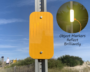 Yellow object marker for roads