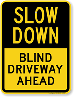 Blind Driveway Ahead Slow Down Sign