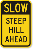 Slow Steep Hill Ahead Sign