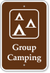 Group Camping with Graphic Campground Sign