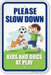 Please Slow Down Kids and Dogs at Play Sign