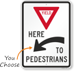 Yield Here To Pedestrians Arrow Sign