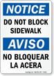 Do Not Block Bilingual Sign