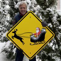 Festive reindeer and santa sleigh sign