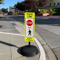 State law stop for pedestrian within crosswalk sign
