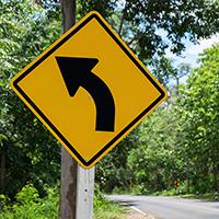 Left Curve Symbol - Traffic Signs